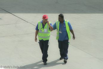 Friends at work, airport workers