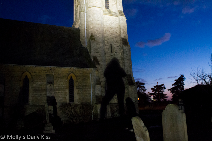 Shadow of Molly on church tower at dusk