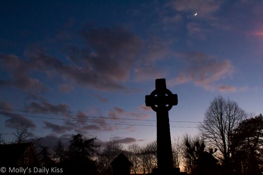 Moon in sky over church yard
