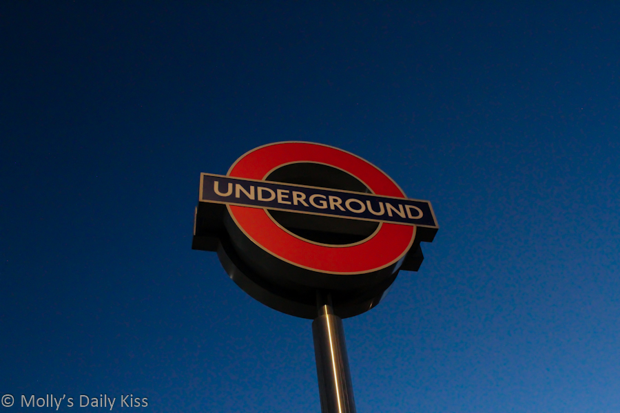 London underground sign against evening blue sky