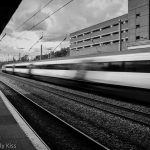Train blur as it rushes throough station