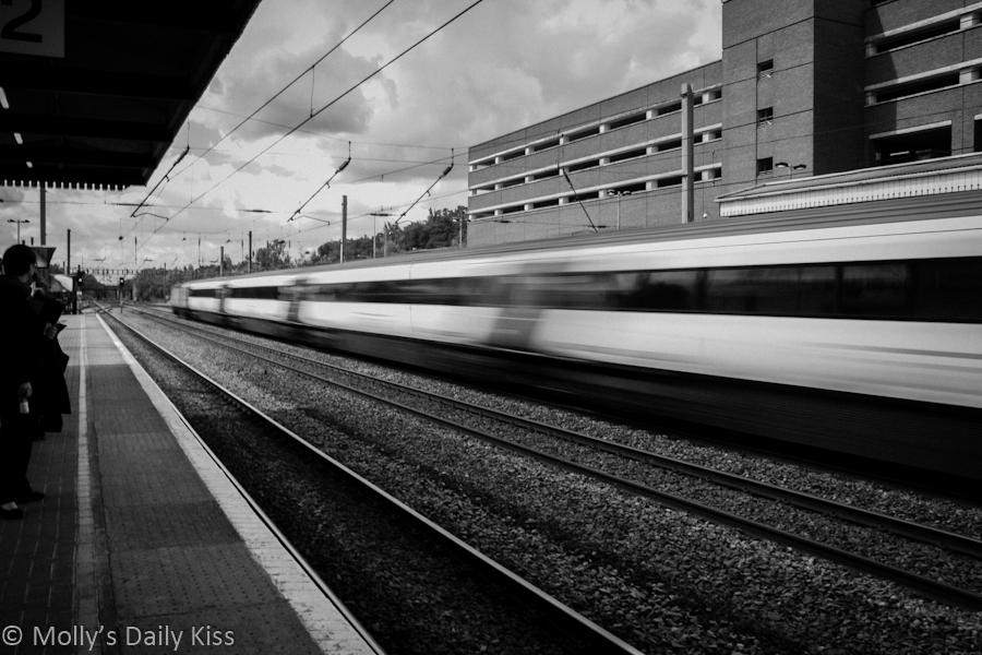 Train blur as it rushes throough station