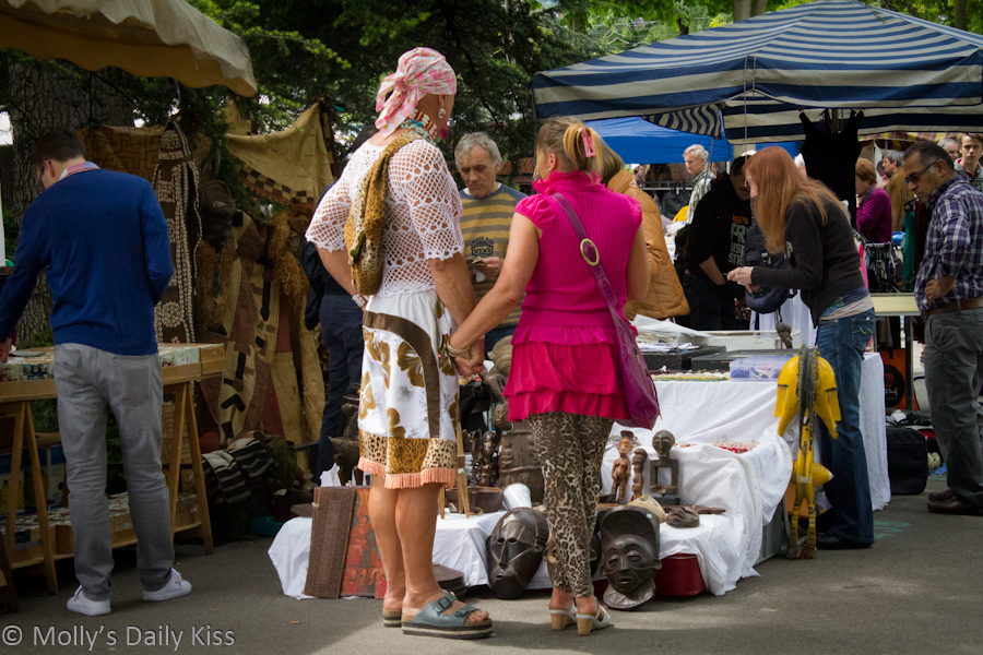 Couple holding hands in Swiss market