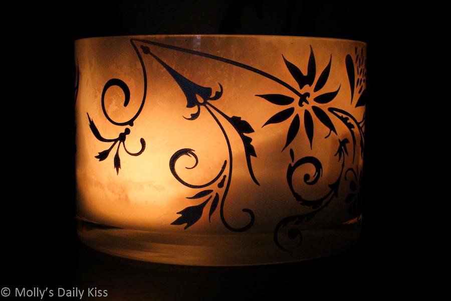 Candle light through glass bowl