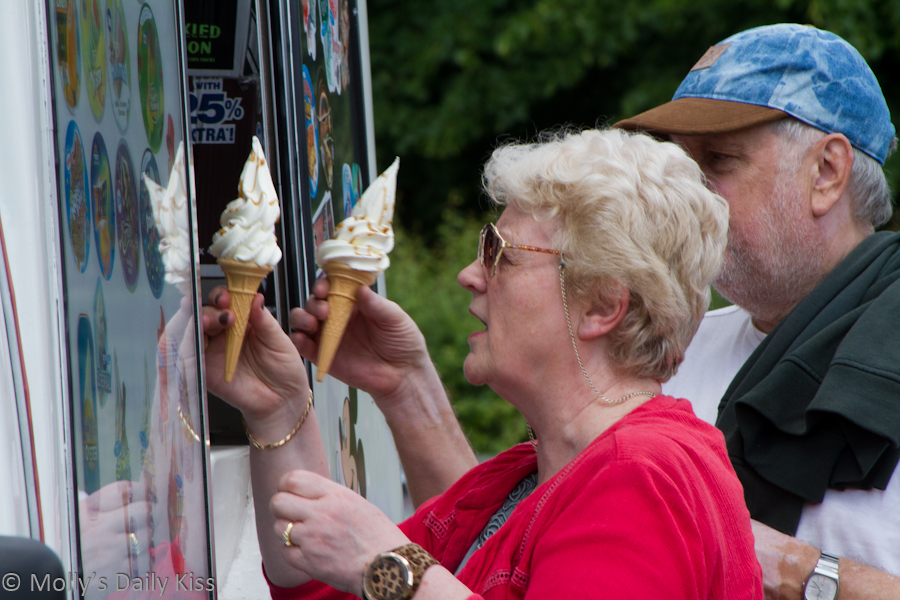 elderly couple buying icecream