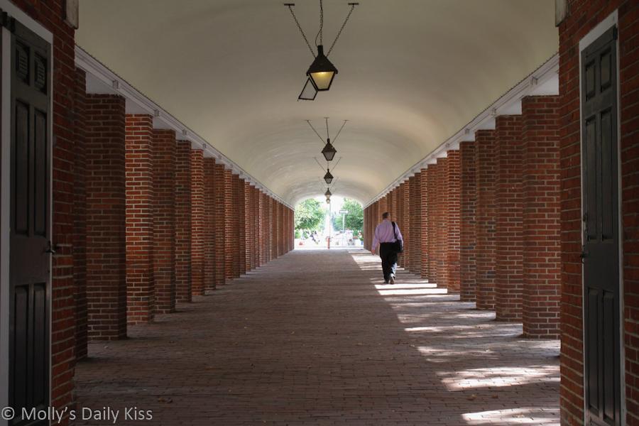 Man walking alone through South Street covered market Philadelphia