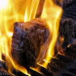 Large steak on the grill with flames