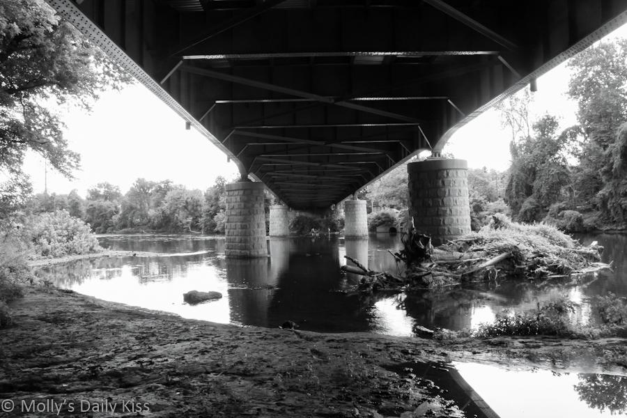 Black and white image under bridge