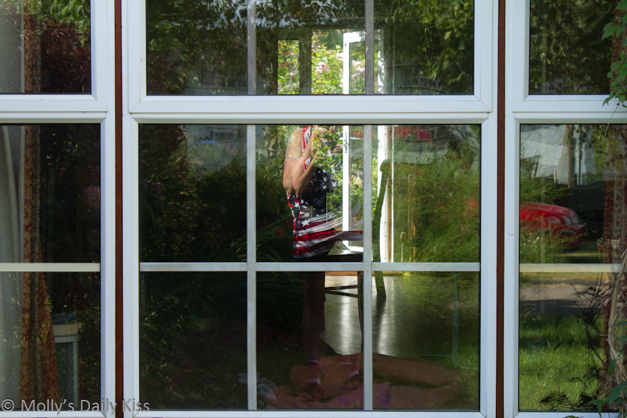 Reflection of me and garden in window
