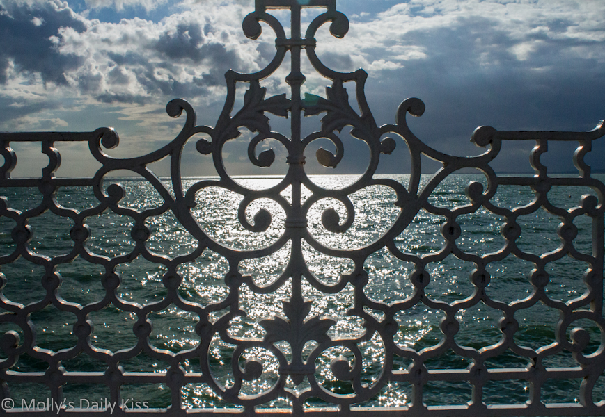 through the fence looking at the sea Brighton
