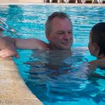 Father and daughter in pool together