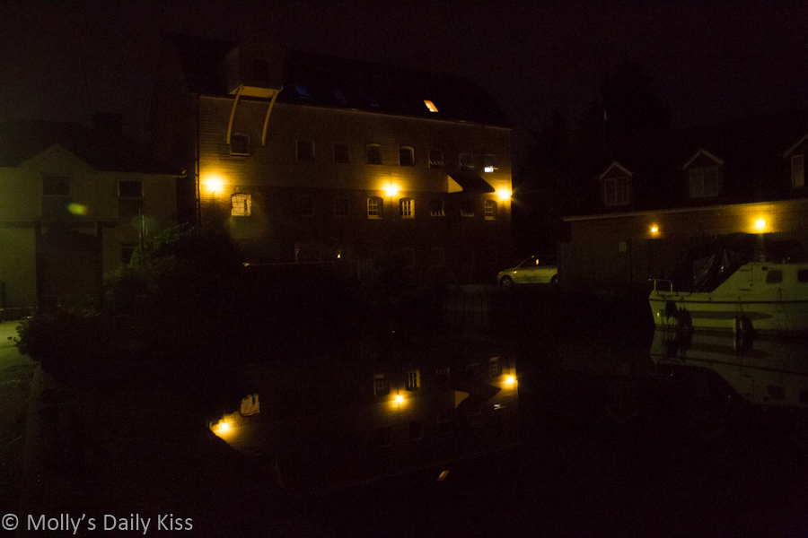 building light reflected in water at night