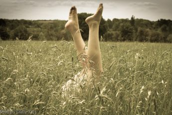Legs in the air in a field of grass
