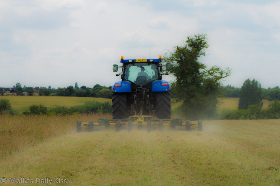 tractor making harvest dust