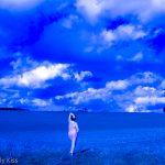Standing below huge blue sky