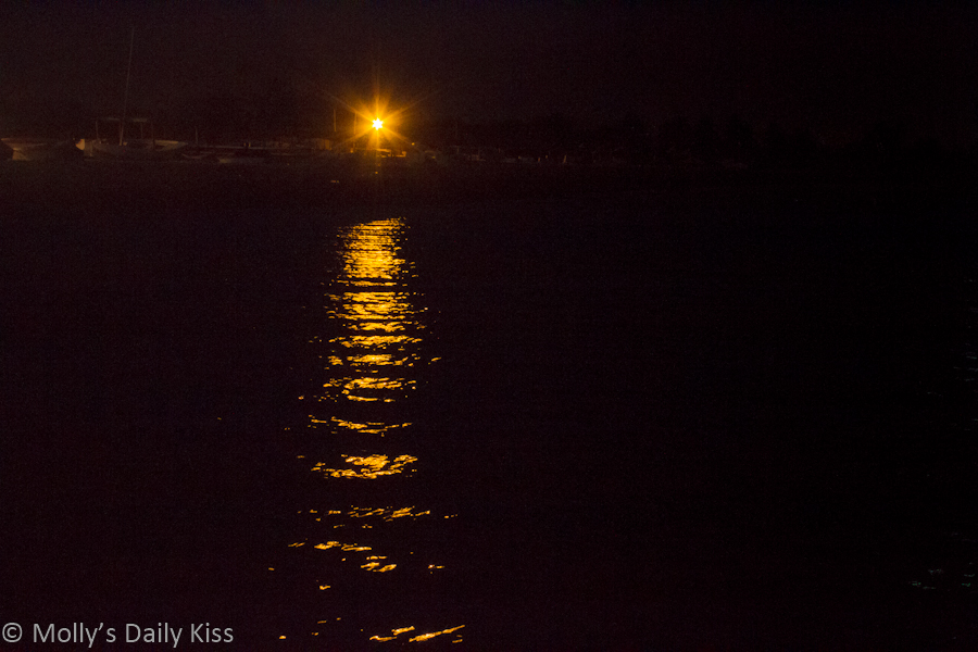 Street light reflected in sea