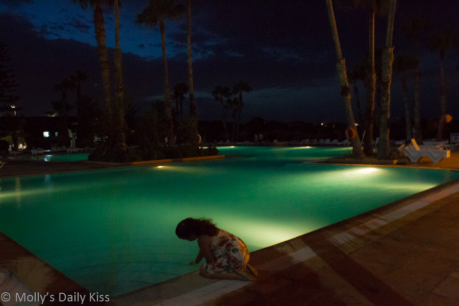 Girl staring into swimming pool