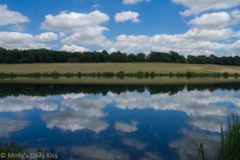 Clouds reflected in pond Panshanger country park