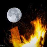 Moon behind fire