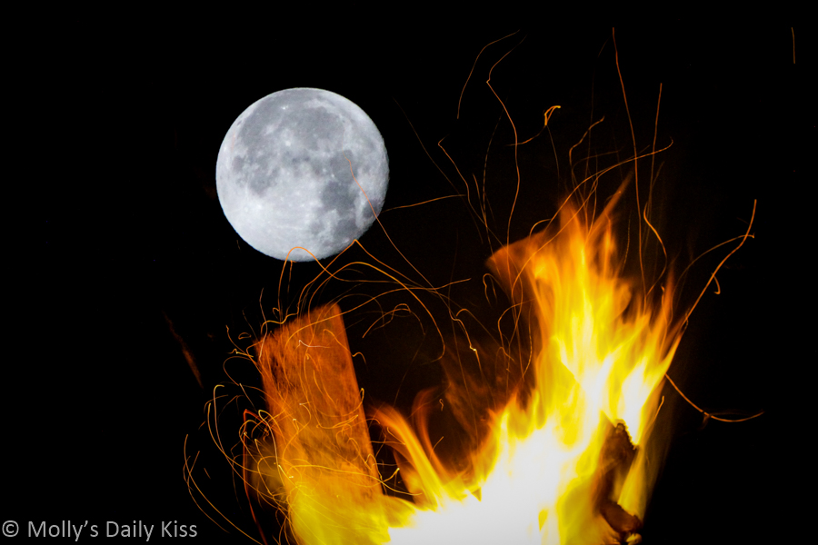 Moon behind fire