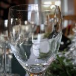 Reflection of Christmas tree in wine glass