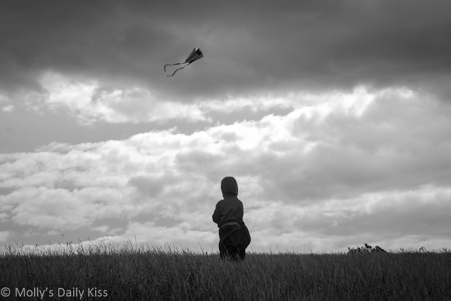 Little boy flying a kite