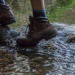 Walking boots across stream self portrait