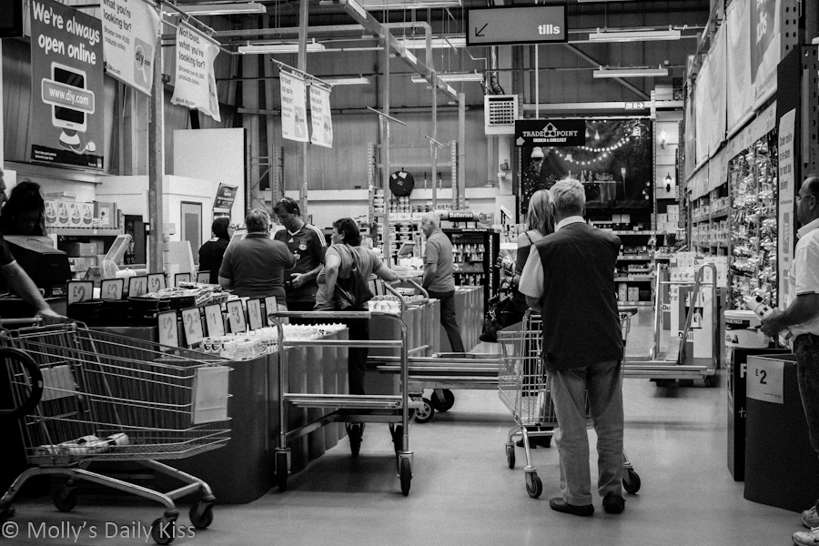 People in a queue in B & Q