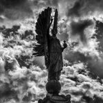 Angel statue against stormy sky
