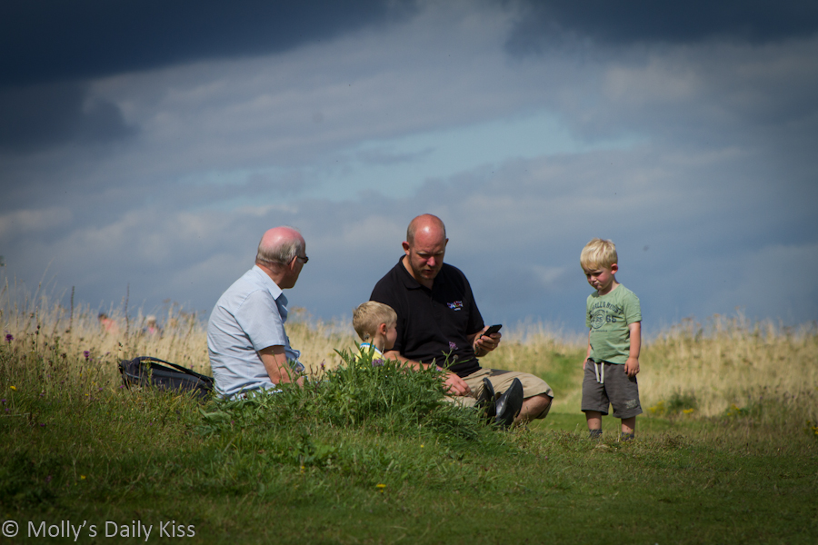 3 generation of men having a picnic
