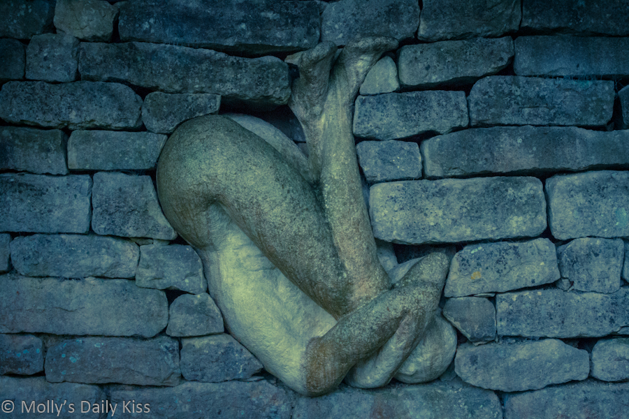 Statue bricked into the wall