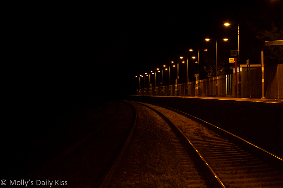 Railways station at night leading into the dark