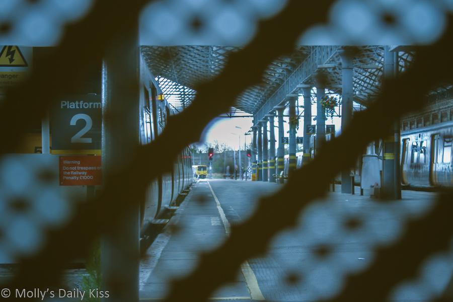 Platform train station through fence