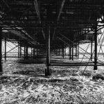 Under the pier Brighton in black and white