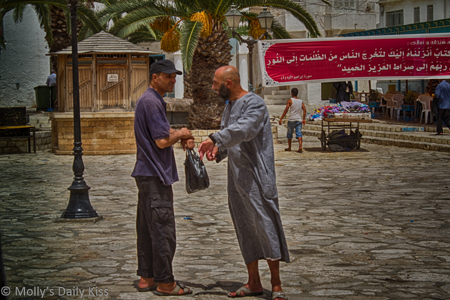Men shaking hands in Tunisia market