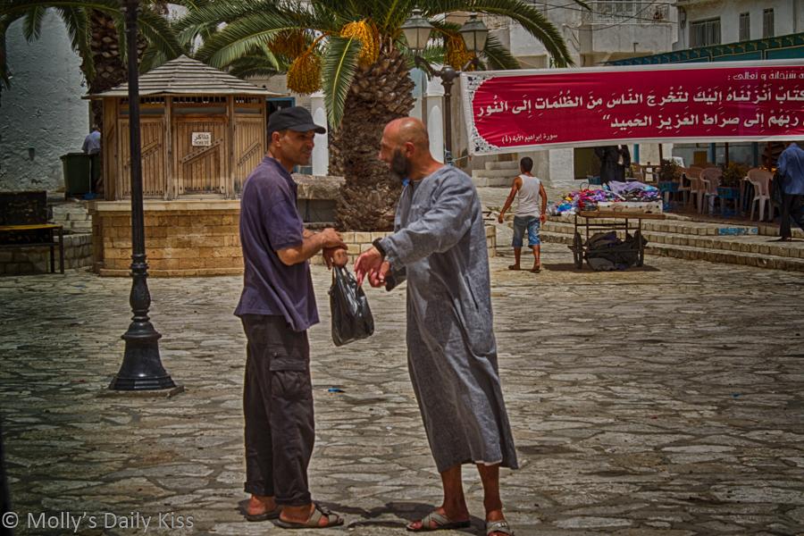 Men shaking hands in Tunisia market