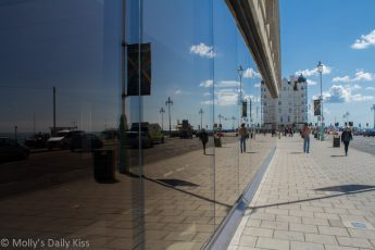 Reflection of Brighton seafront in glass building