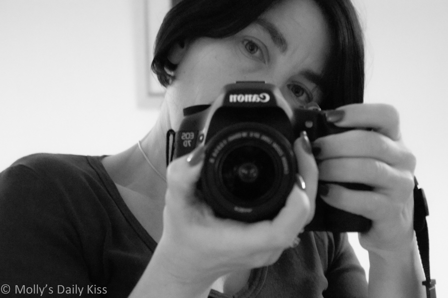 Self portrait with camera in black and white