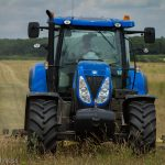 tractor cutting meadow grass