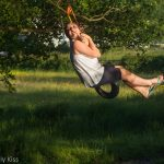 Girl on swing over river