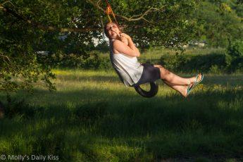 Girl on swing over river