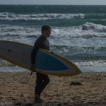 Man on compton beach with surf board