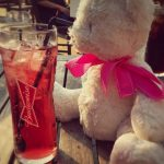 Teddy bear with pink bow around his neck