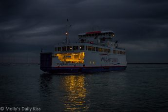 Isle of Wight ferry at night reflected in the water