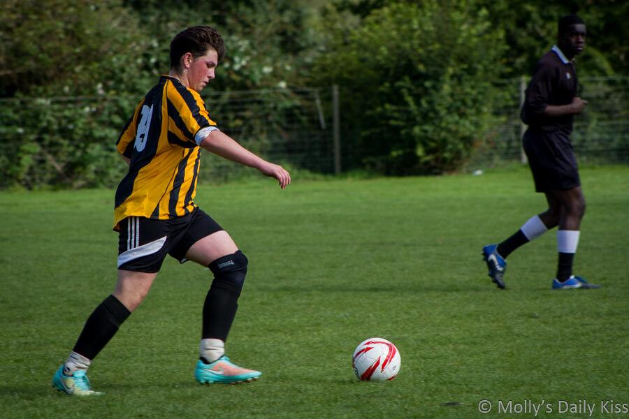 Young footballer taking free kick