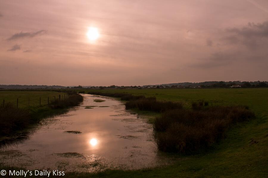Hazy sunlight reflected in river