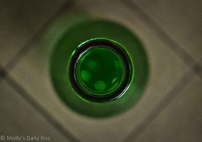 Looking down into a green glass bottle