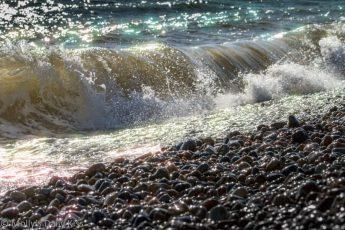 Wave crashing onto Brighton beach
