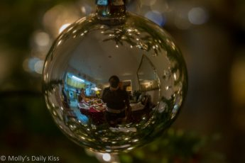 Self portrait reflection in Christmas bauble