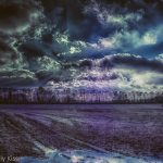 Dramatic winter sky over fields in HDR